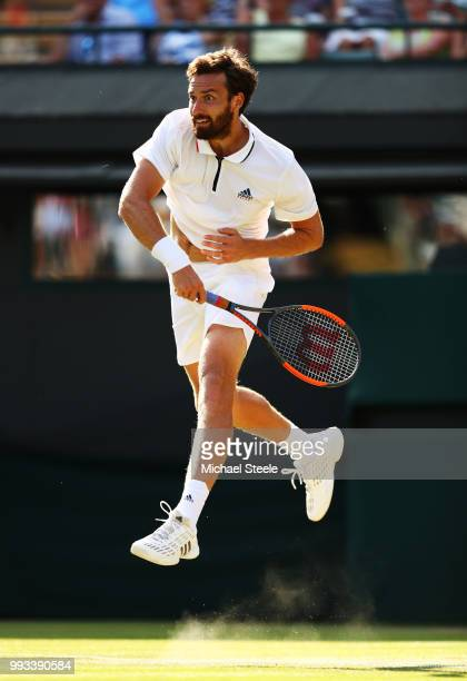 Ernests Gulbis of Latvia returns a shot against Alexander Zverev of Germany during their Men's Singles third round match on day six of the Wimbledon...
