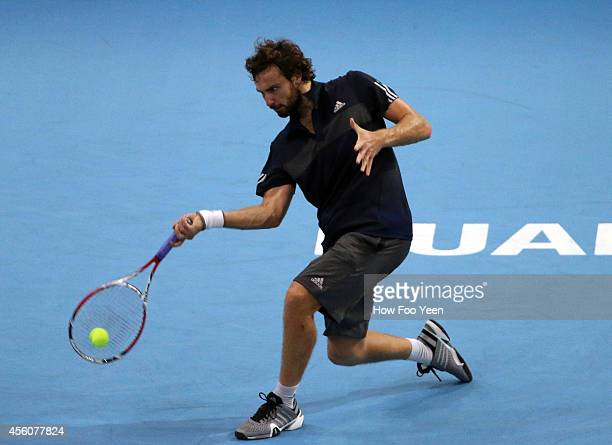 Ernests Gulbis of Latvia returns a shot against Philipp Petzschner of Germany during the Malaysian Open at Putra Stadium on September 25 2014 in...