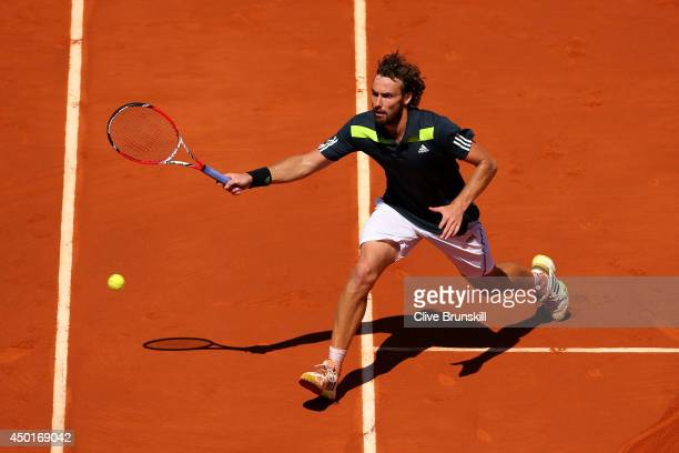 Ernests Gulbis of Latvia returns a shot during his men's singles semi-final match against Novak Djokovic of Serbia on day thirteen of the French Open...