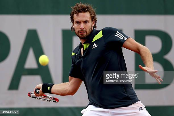 Ernests Gulbis of Latvia returns a shot during his men's singles quarterfinal match against Tomas Berdych of Czech Republic on day ten of the French...