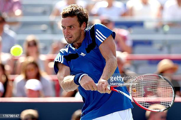 Ernests Gulbis of Latvia returns a shot to Andy Murray of Great Britain during the Rogers Cup at Uniprix Stadium on August 8 2013 in Montreal Quebec...