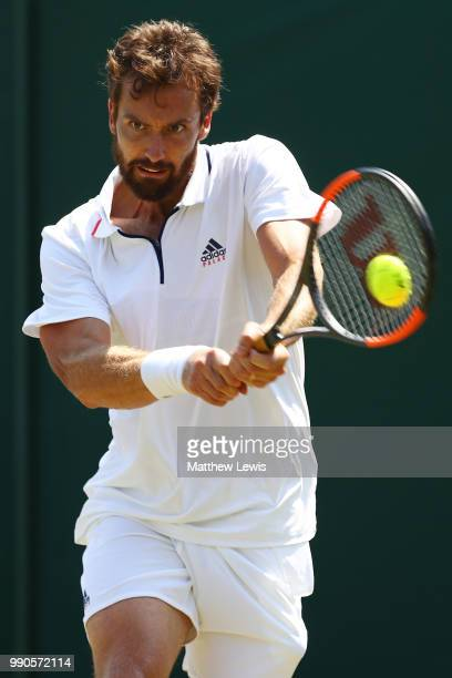 Ernests Gulbis of Latvia returns against Jay Clarke of Great Britain during their Men's Singles first round match on day two of the Wimbledon Lawn...