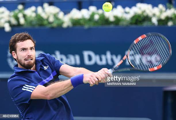 Ernests Gulbis of Latvia returns the ball to Denis Istomin of Uzbekistan during their match in the first day of the ATP Dubai Duty Free Tennis...