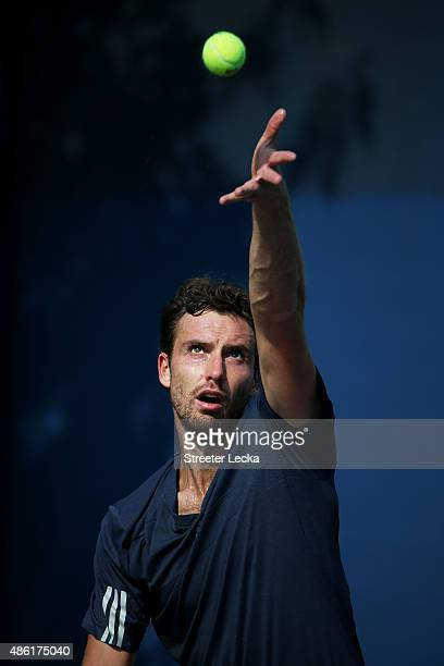 Ernests Gulbis of Latvia serves against Aljaz Bedene of Great Britain during their Men's Singles First Round match on Day Two of the 2015 US Open at...