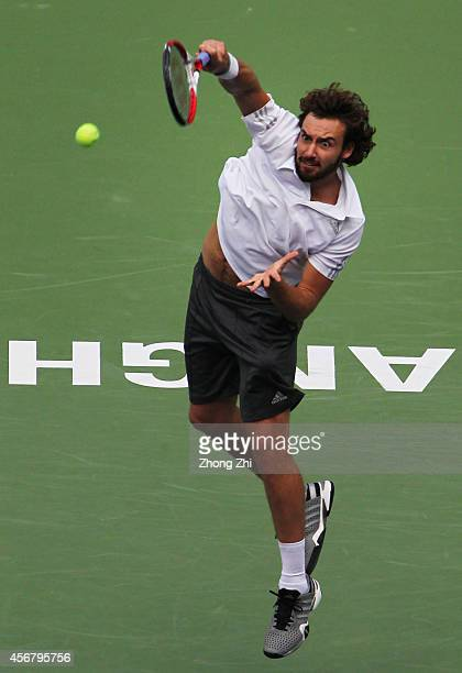 Ernests Gulbis of Latvia serves during his match against Mikhail Youzhny of Russia during the day 3 of the Shanghai Rolex Masters at the Qi Zhong...