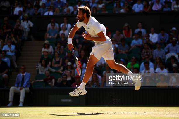 Ernests Gulbis of Latvia serves during the Gentlemen's Singles third round match against Novak Djokovic of Serbia on day six of the Wimbledon Lawn...