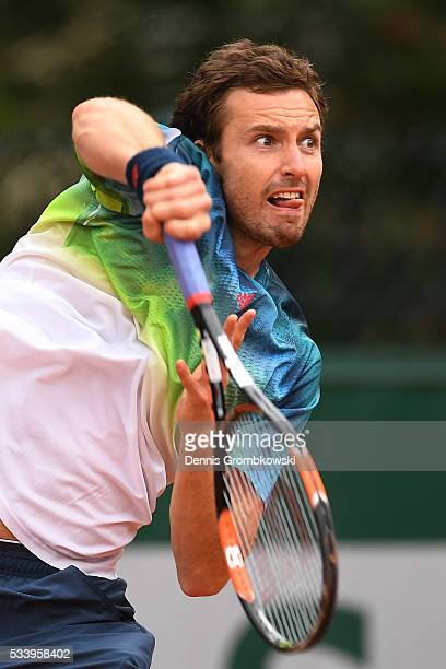 Ernests Gulbis of Latvia serves during the Men's Singles first round match against Andreas Seppi of Italy on day three of the 2016 French Open at...