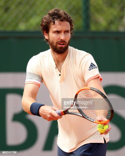 Ernests Gulbis of Latvia serves during the mens singles first round match against Gilles Muller of Luxembourg during day two of the 2018 French Open...