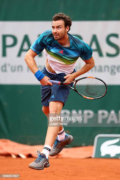 Ernests Gulbis of Latvia serves during the Men's Singles fourth round match against David Goffin of Belgium on day eleven of the 2016 French Open at...