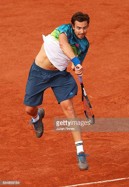 Ernests Gulbis of Latvia serves during the Men's Singles third round match against JoWilfried Tsonga of France on day seven of the 2016 French Open...