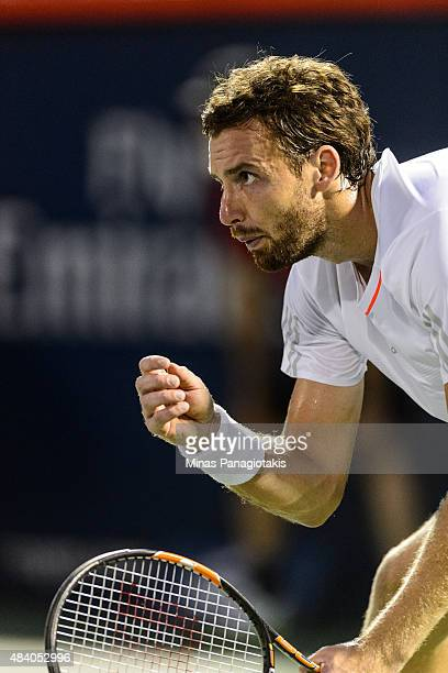 Ernests Gulbis of Latvia waits to receive a serve from Novak Djokovic of Serbia during day five of the Rogers Cup at Uniprix Stadium on August 14...