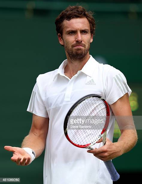 Ernests Gulbis reacts during his Gentlemen's Singles first round match against Jurgen Zopp of Estonia on day one of the Wimbledon Lawn Tennis...