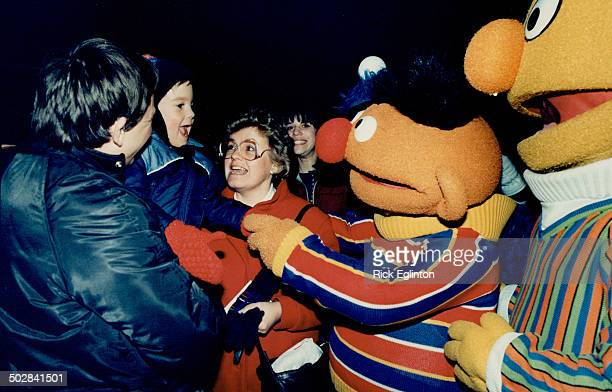 Ernie and Bert frolic on Front St Popular Sesame Street characters Ernie and Bert gladhand one of their tiny fans outside the O'Keefe Centre last...