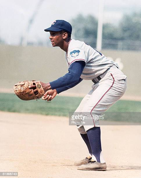 Ernie Banks of the Chicago Cubs focuses on home plate as he fields his position during a game circa 1953-1971.