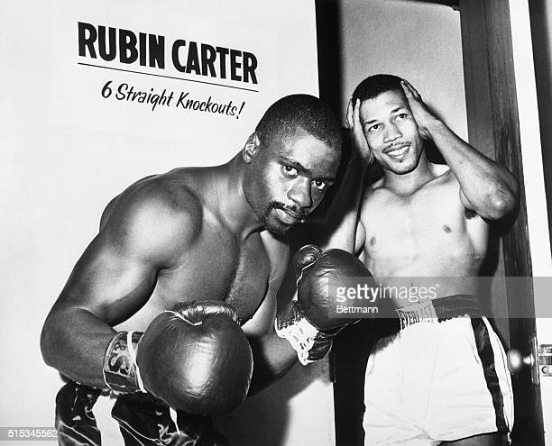 Ernie Buford seems bewildered by the knockout record of Rubin 'Hurricane' Carter as the two met during a gym workout They'll meet again June 23rd...