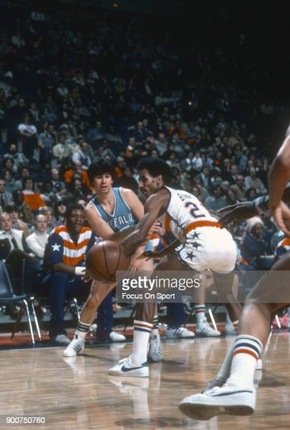 Ernie DiGregorio of the Buffalo Braves passes the ball by Dave Bing of the Washington Bullets during an NBA basketball game circa 1977 at the Capital...