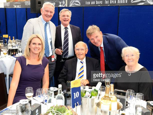 Ernie Els and his wif Leizl of South Africa pose with Renton Laidlaw of Scotland the former television broadcaster and Chairman and Secretary of the...