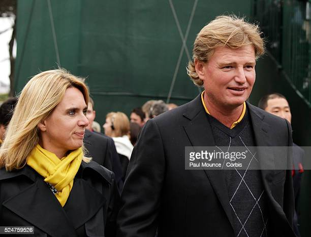 Ernie Els and his wife arrive during the closing ceremony for the 2009 President's Cup held at Harding Park Golf Course in San Francisco