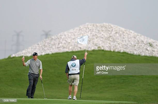 Ernie Els from South Africa putts out on the 9th while playing the continued round four Els won by 13 strokes at 26 under par BMW Asian Open Tomson...