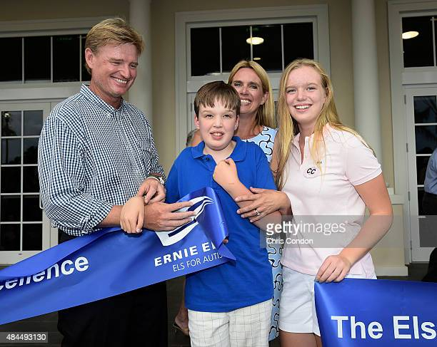 Ernie Els his wife Liezl son Ben and daughter Samantha pose with the ribbon during The Els Center for Excellence Grand Opening Ceremony on August 17...