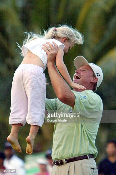 Ernie Els lifts his daughter Samantha after winning the sudden death playoff against Harrison Frazar on the 11th hole during the final round of the...