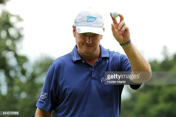Ernie Els of South Africa acknowledges the gallery after finishing on the 18th green during the third round of The Barclays at The Ridgewood Country...