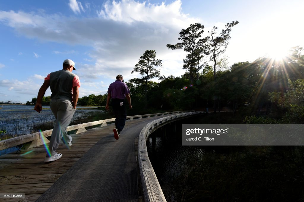 Ernie Els of South Africa (R) and Alex Noren of Sweden walks to the 11th tee during round two of the Wells Fargo Championship at Eagle Point Golf Club on May 5, 2017 in Wilmington, North Carolina.