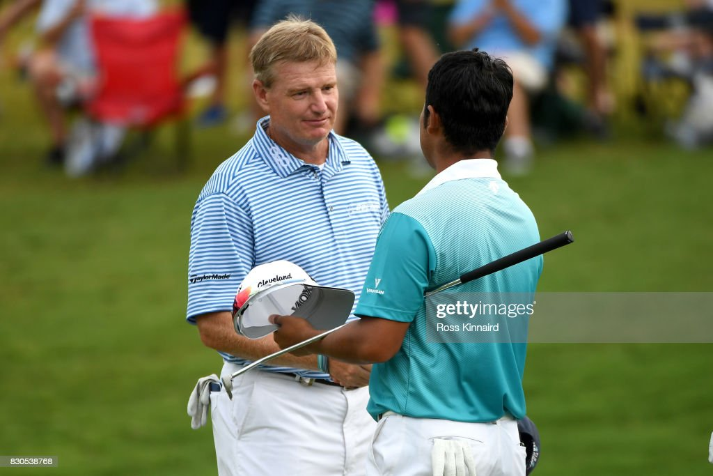 Ernie Els of South Africa and Hideki Matsuyama of Japan shakes hands after their round on the 18th green during the second round of the 2017 PGA Championship at Quail Hollow Club on August 11, 2017 in Charlotte, North Carolina.