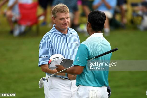 Ernie Els of South Africa and Hideki Matsuyama of Japan shakes hands after their round on the 18th green during the second round of the 2017 PGA...