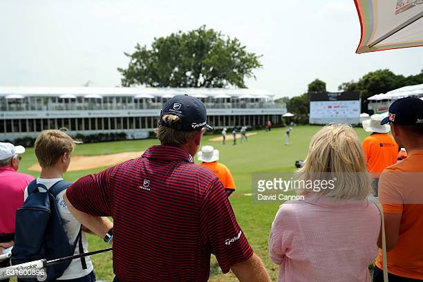 Ernie Els of South Africa and his sister Carina Rebula watch his nephew Jovan Rebula on the 18th green during the second round of the 2017 BMW South...