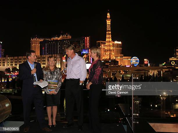 Ernie Els of South Africa and his wife Liezl Els and Maura Nolan with Steve Sands of the Golf Channel as they announce the Irish Links raffle winners...