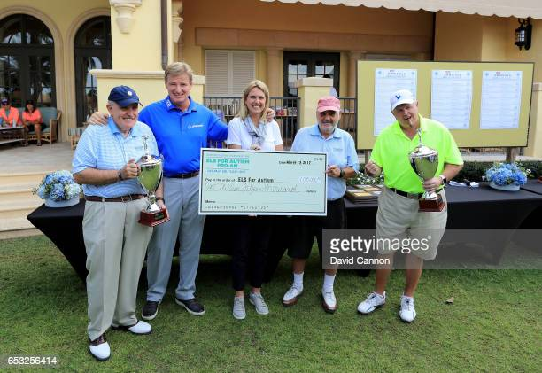 Ernie Els of South Africa and his wife Liezl Els pose with the check for $1000 and the winning team Rudy Guiliani Marvin Shanken Rush Limbaugh of...