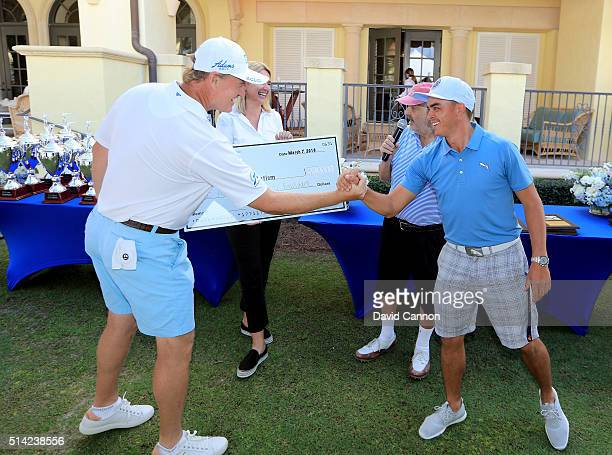 Ernie Els of South Africa and his wife Liezl Els thank Rickie Fowler of the United States who had just holed in one in the $1 million HoleInOne...
