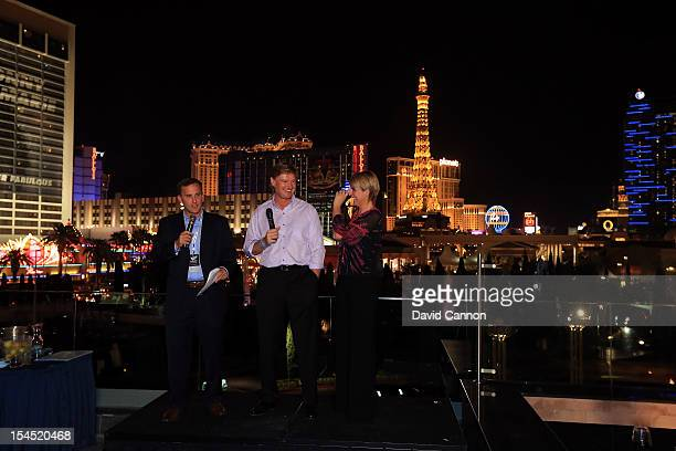 Ernie Els of South Africa and his wife Liezl Els with Steve Sands of the Golf Channel during the Welcome Reception at the 'Pure' nightclub at The...