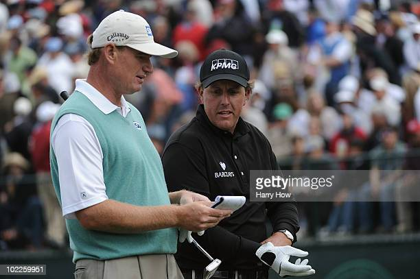 Ernie Els of South Africa and Phil Mickelson check their yardage on the 13th hole during the final round of the 110th US Open at Pebble Beach Golf...