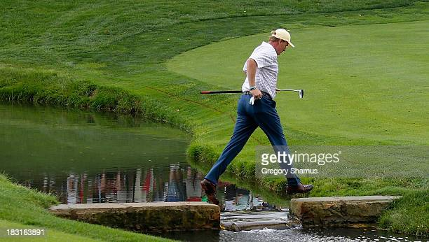 Ernie Els of South Africa and the International Team crosses a bridge on the 14th hole during the Day Three Four-ball Matches at the Muirfield...