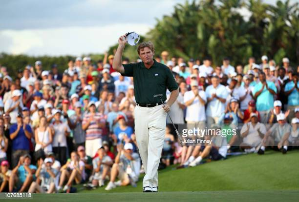 Ernie Els of South Africa celebrates after his final putt on the 18th green to win during round four of the South African Open Golf Championship at...