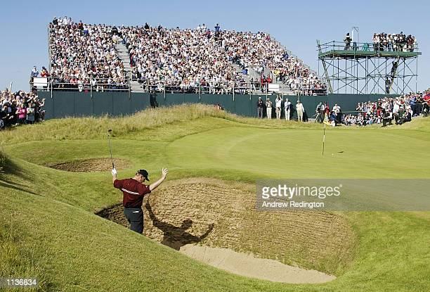Ernie Els of South Africa celebrates his chip out of the bunker on the 13th green during the final round of the 131st Open Championships at Muirfield...