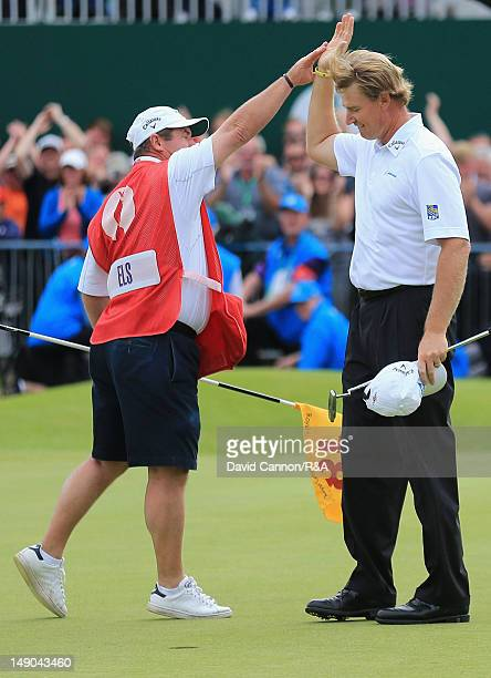 Ernie Els of South Africa celebrates his putt for birdie on the 18th green with caddie Ricci Roberts during the final round of the 141st Open...