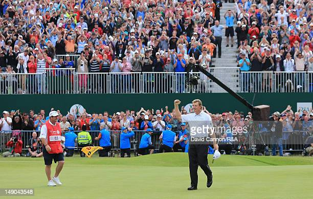 Ernie Els of South Africa celebrates holing his putt for birdie on the 18th green with caddie Ricci Roberts during the final round of the 141st Open...