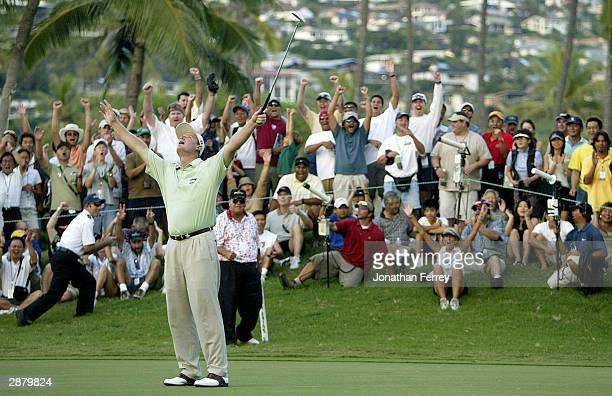 Ernie Els of South Africa celebrates sinking his birdie putt on the 3rd playoff hole to defeat Harrison Frazar during the final round of the PGA Tour...