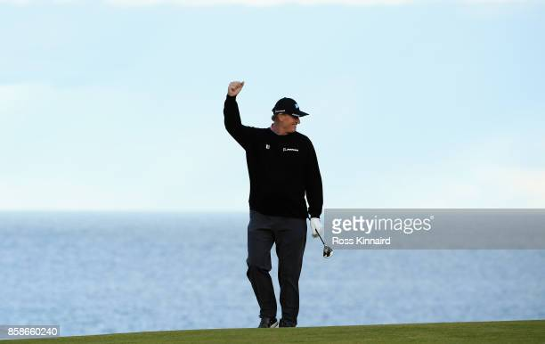Ernie Els of South Africa celebrates the shot of Rurik Gobel Businessman on the 9th hole during day three of the 2017 Alfred Dunhill Championship at...