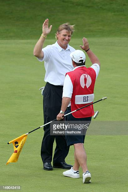Ernie Els of South Africa celebrates with his caddie Ricci Roberts after a birdie putt on the 18th green during the final round of the 141st Open...