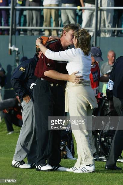 Ernie Els of South Africa celebrates with his wife on the 18th green after winning the final round of the 131st Open Championships at Muirfield Golf...