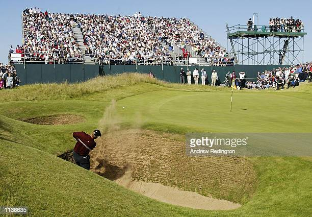 Ernie Els of South Africa chips out of the bunker on the 13th green during the final round of the 131st Open Championships at Muirfield Golf Club...