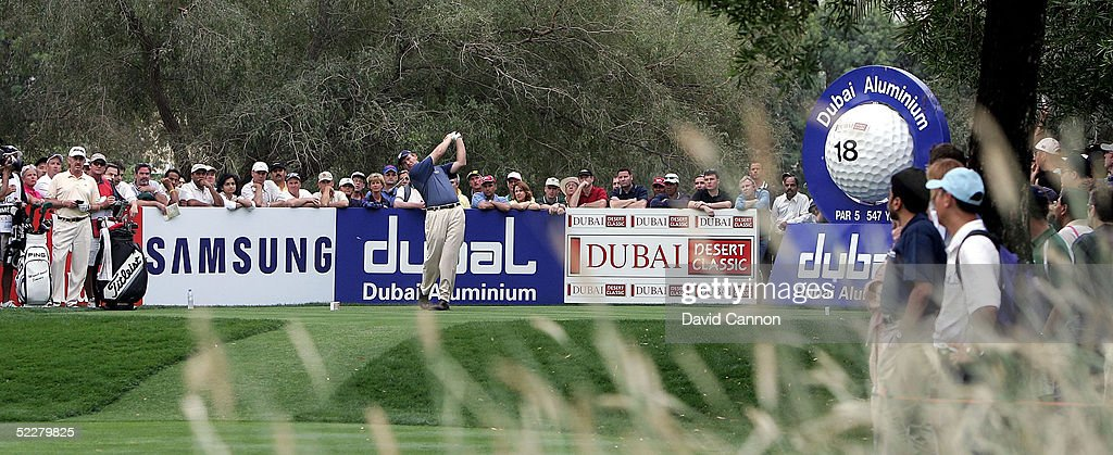 Ernie Els of South Africa drives at the 18th during the third round of the 2005 Dubai Desert Classic on the Majilis Course at the Emirates Golf Club, on March 05, 2005, in Dubai, United Arab Emirates.
