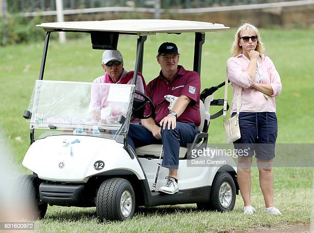 Ernie Els of South Africa his father Nils Els and his sister Carina Rebula watch his nephew Jovan Rebula on the first hole during the second round of...