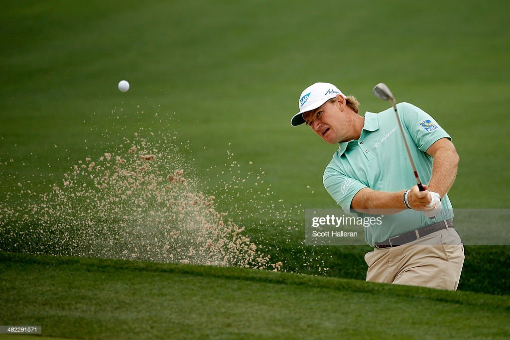 Ernie Els of South Africa hits a shot out of the bunker on the eighth hole during round one of the Shell Houston Open at the Golf Club of Houston on April 3, 2014 in Humble, Texas.