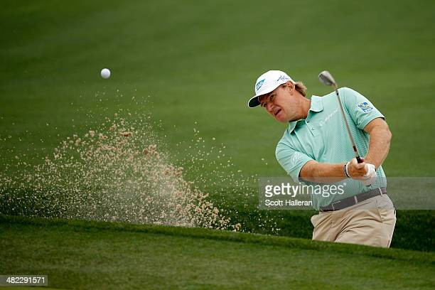 Ernie Els of South Africa hits a shot out of the bunker on the eighth hole during round one of the Shell Houston Open at the Golf Club of Houston on...