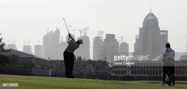 Ernie Els of South Africa hits his second shot on the par 5 18th hole during the final round of the 2006 Dubai Desert Classic on the Majilis Course...